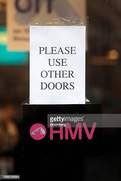 A sign alerts customers to use another door outside an HMV store in London UK on Tuesday Jan 15 2013 Endless LLP a privateequity firm that focuses on...