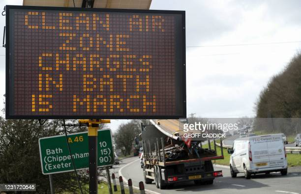 Sign alerts drivers to Bath's incoming new Clean Air Zone charges on a road 10 miles from Bath, southwest England, on March 12, 2021. - From March...