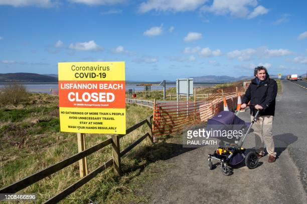 Sign alerts people to the closure of a beach, due to Covid-19, in Lisfannon, north Ireland on March 28 as life in Ireland continues during the...