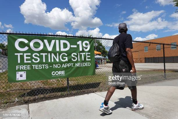 Sign alerts residents to a mobile COVID-19 testing site set up on a vacant lot in the Austin neighborhood on June 23, 2020 in Chicago, Illinois. The...