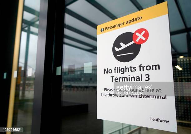 Sign alerts travels to the closure of Terminal 3 at Heathrow Airport in west London on December 21 as a string of countries around the world banned...