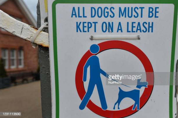Sign 'All Dogs Must Be Kept On A Leash' seen at the entrance to People's Park, Dún Laoghaire area of Dublin, during Level 5 Covid-19 lockdown. On...