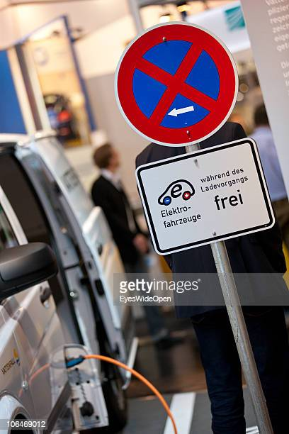 A sign allows parking only while charging an elecric car at a quick charge station on the eCarTec 2010 the 2nd International trade fair for electric...