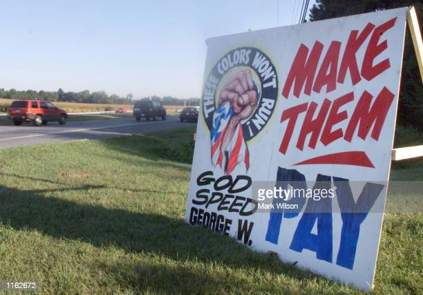 A sign along a highway urges US President George W Bush to Make Them Pay September 13 2001 in Dunkirk Maryland two days after the terrorist attacks...