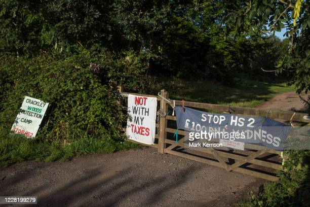 Sign and banners are displayed at the entrance to Crackley Woods Protection Camp on 24th August 2020 in Kenilworth, United Kingdom. Anti-HS2...