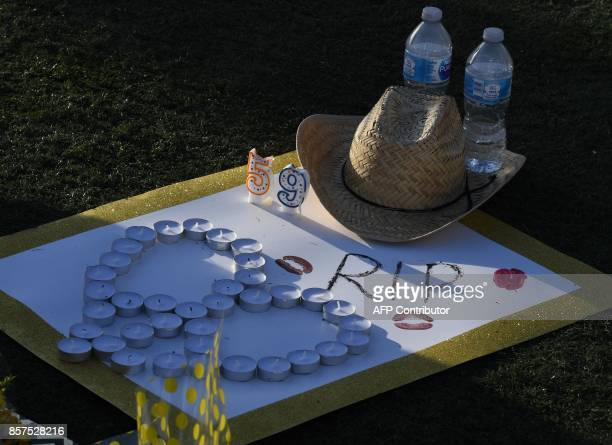A sign and cowboy hat left at a makeshift memorial are seen outside the Route 91 music festival site beside the Mandalay Hotel October 4 2017 on the...