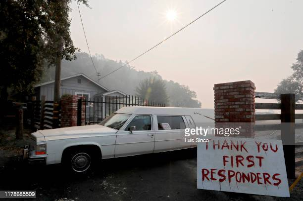 A sign and hearse give a nod to Halloween and firefighters along Faught Road in Windsor on Monday Oct 28 2019