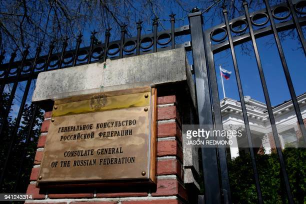 A sign and Russian flag are pictured at the residence of the consulate general of Russia at the historic Samuel Hyde House in Seattle Washington on...