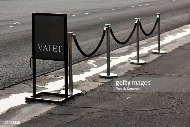 Sign and stanchions for valet parking