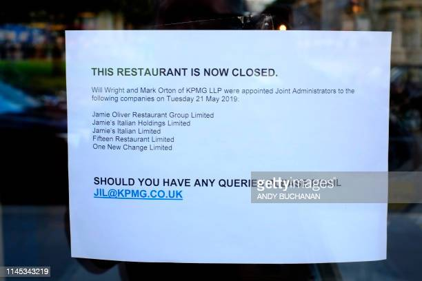 A sign annouces the closure of a Jamie's Italian restaurant in Glasgow on May 21 2019 British celebrity TV chef Jamie Oliver said Tuesday that he was...
