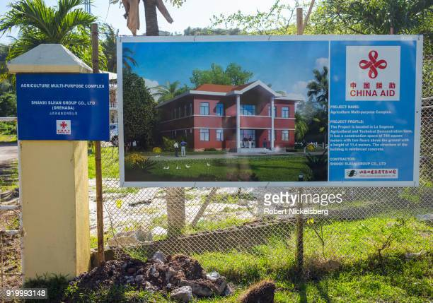 A sign announces Chinese economic aid for the construction of a Grenadian government agriculture building February 12 2018 at La Sagesse Beach...