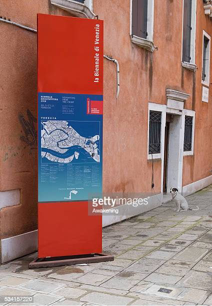 A sign announces the beginning of the 15th Architecture Venice Biennale on May 25 2016 in Venice Italy The 56th International Architecture Exhibition...
