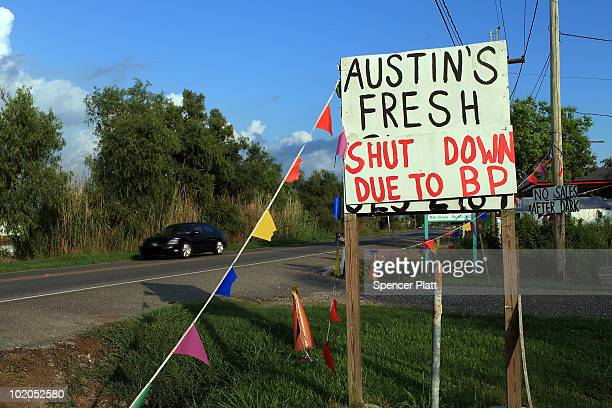 A sign announces the closing of a seafood stand due to the oil spill June 13 2010 in Lafourche Louisiana The spill has been called the largest...