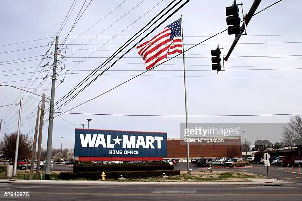 A sign announces the headquarters of the wordl's biggest corporation WalMart on Walton Blvd named after WalMart founder Sam Walton March 16 2005 in...