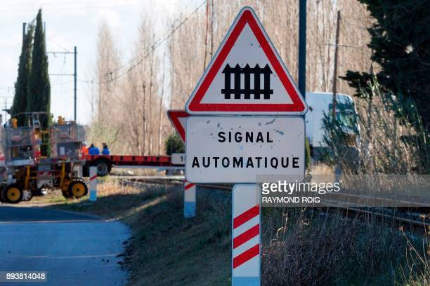 A sign announcing a level crossing is pictured in Millas as gendarmes investigate on December 16 two days after some children were involved in an...
