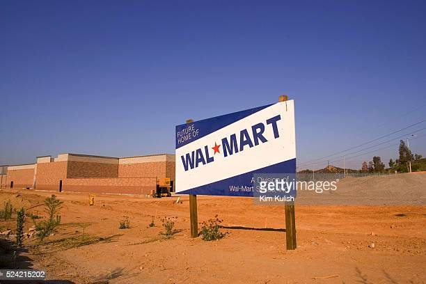 A sign announcing a new WalMart coming soon to Santa Clarita is seen located 30 miles north of Los Angeles The Los Angeles City council last week...