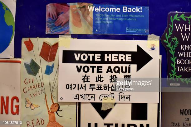 A sign announcing a polling station is seen inside of PS 69 November 6 2018 in the Jackson Heights neighborhood of the Queens borough of New York City