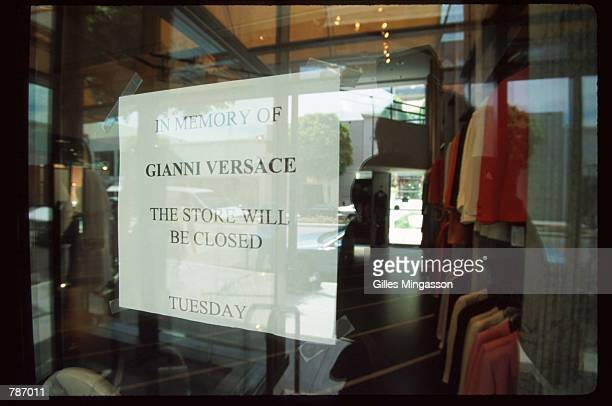 A sign announcing store closure hangs in the window at a Versace store after the murder of designer Gianni Versace July 15 1997 in Beverly Hills CA...