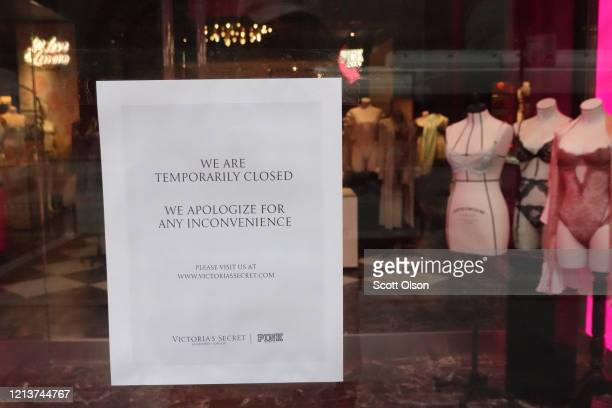 Sign announcing that it is closed is seen in a Victoria's Secret store along the Magnificent Mile shopping district on March 20, 2020 in Chicago,...
