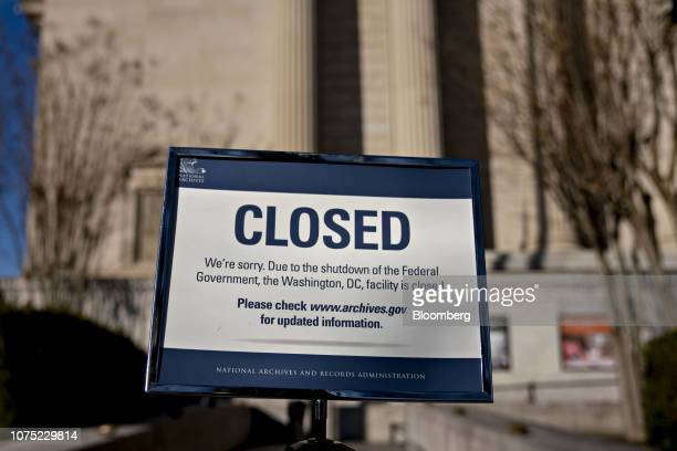Sign announcing the closure of the National Archives due to a partial government shutdown is displayed in Washington, D.C., U.S., on Thursday, Dec....