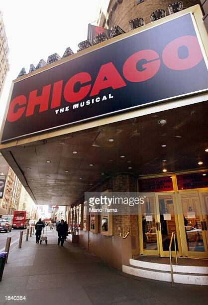 A sign announcing the musical Chicago is seen above the Ambassador Theatre March 10 2003 in New York City Broadway musicians are on strike over plans...