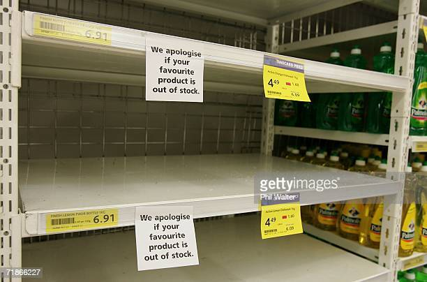 Sign apologises to customers for the lack of stock on empty supermarket shelves as the Supermarket Workers strike enters its 19th day on September...