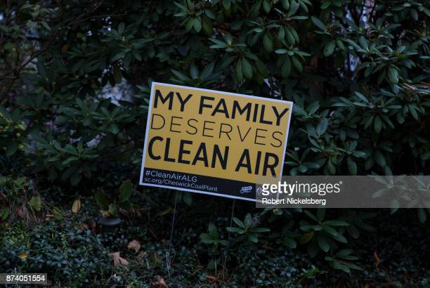 A sign appealing for clean air stands in a garden near the 47year old Cheswick coalfired power plant October 26 2017 in Springdale Pennsylvania Local...