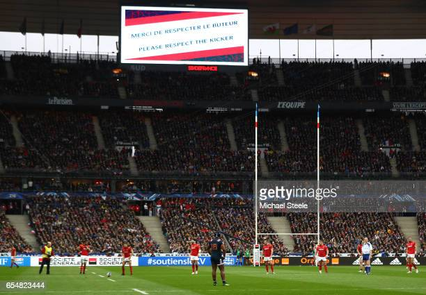 A sign asking for quiet for kicker is displayed as the France fans boo Leigh Halfpenny of Wales as he kicks at goal during the RBS Six Nations match...