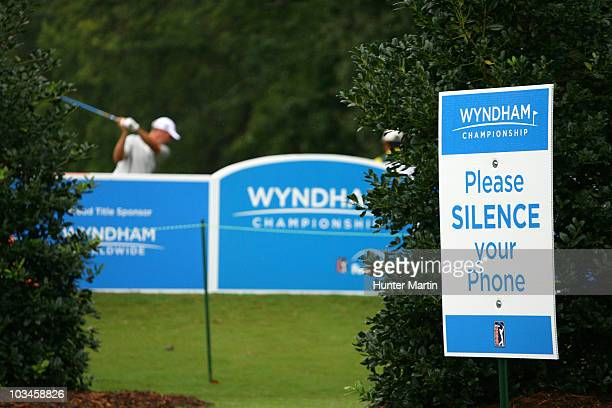 A sign asking for silence is posted next to the 15th tee box during the first round of the Wyndham Championship at Sedgefield Country Club on August...