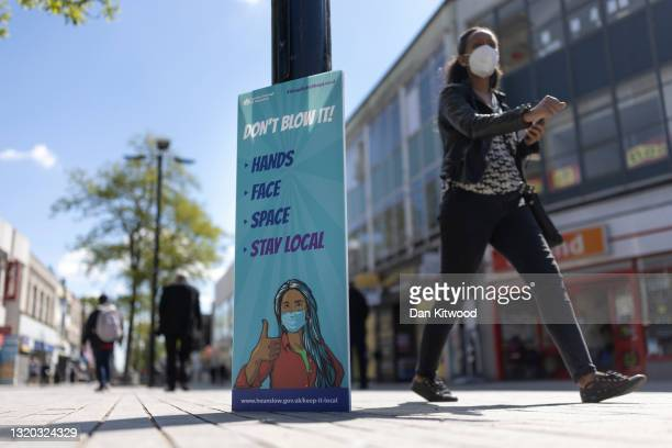 Sign asking people to stay local is displayed on May 27, 2021 in Hounslow, England. The London borough of Hounslow is one of eight locations around...