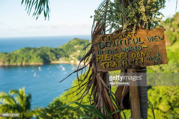 a sign asking readers not to trash the most beautiful view in the world at castara bay in tobago, trinidad and tobago, west indies, caribbean, central america - tobago stock pictures, royalty-free photos & images