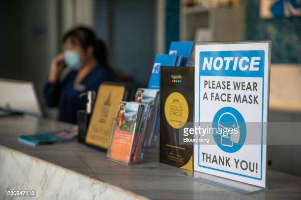 Sign asking visitors to wear masks at the reception of Hotel Clover Patong Phuket in Patong, Phuket, Thailand, on Saturday, Dec. 19, 2020. The tepid...
