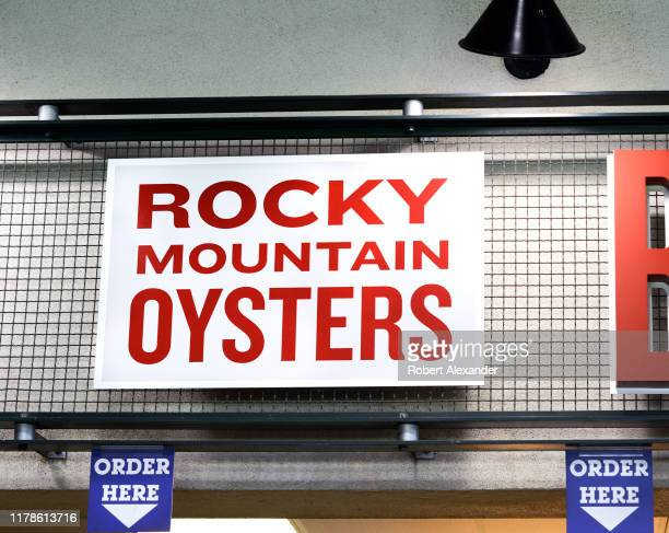 A sign at a food stand in Coors Field advertises its 'Rocky Mountain oysters' which are deep fried bull testicles Coors Field in Denver Colorado is...