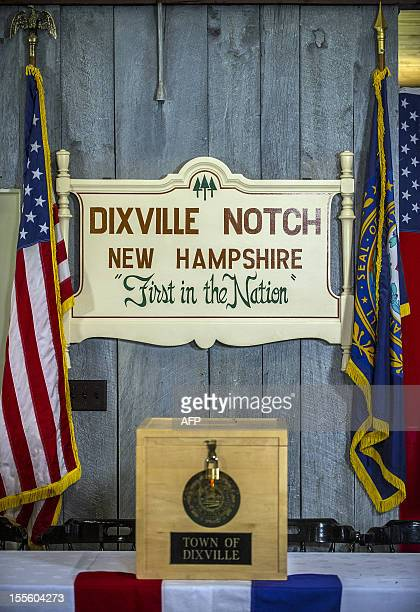 A sign at a polling station is pictured on November 5 2012 in Dixville Notch New hampshire where the first voting in the 2012 US presidential...