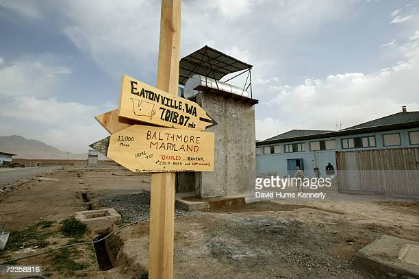 A sign at a Provincial Reconstruction Team site points out how far away the United States is February 26 2004 near Kandahar Afghanistan Secretary of...