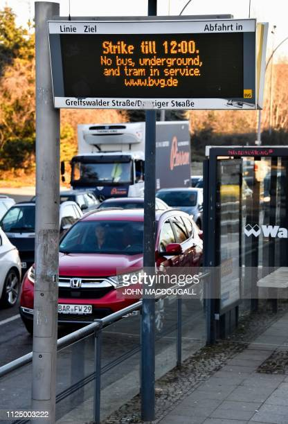 A sign at a tramway stop warns of a strike of Berlin public transport services BVG as traffic builds up along in Berlin on February 15 2019 A total...