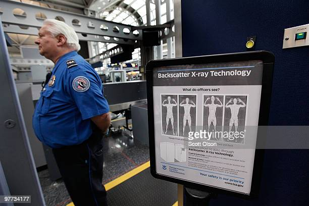 A sign at a Transportation Security Administration checkpoint instructs passengers about the use of the fullbody scanner at O'Hare International...