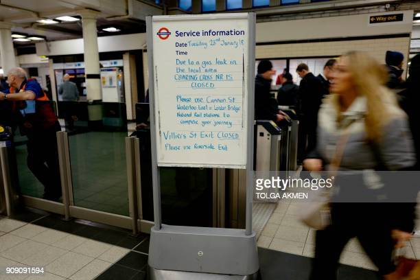 A sign at a tube station advises passengers that Charing Cross railway station is closed because of a gas leak in London on January 23 2018 Almost...