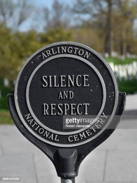 A sign at Arlington National Cemetery urges visitors to observe silence and respect for the US military veterans and their spouses buried at the...