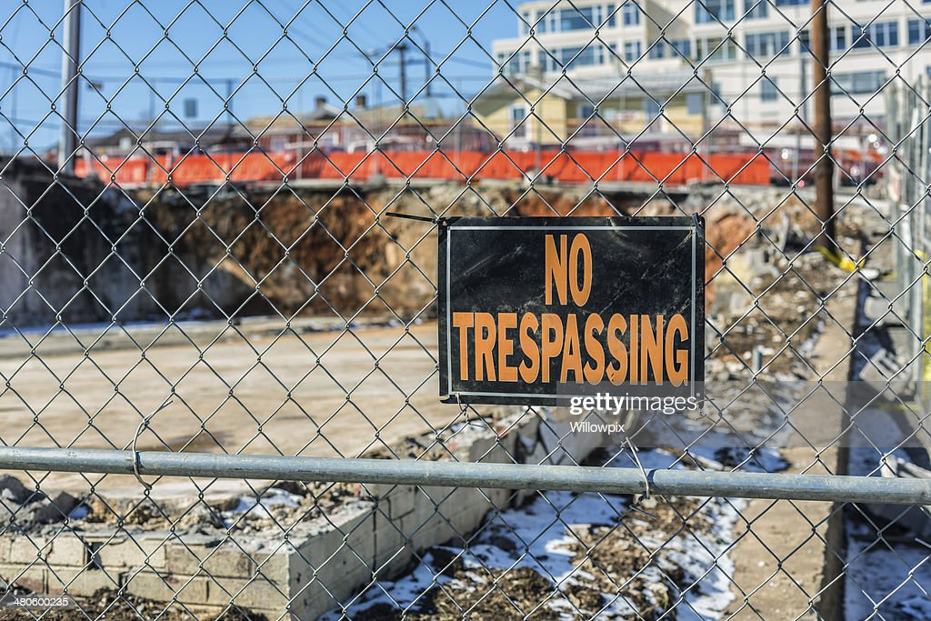 NO TRESPASSING Sign At Demolition Site : Stock Photo