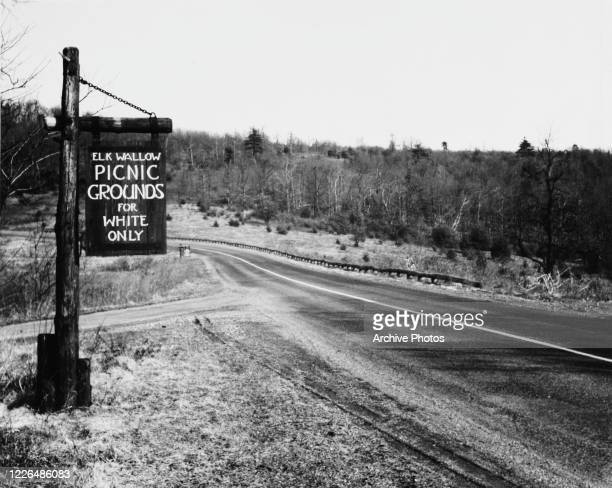 Sign at Elkwallow Picnic Grounds in Shenandoah National Park, Virginia, reading 'Picnic grounds for white only', USA, circa 1940.