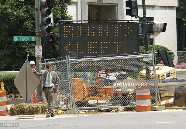 LEFTA sign at First and Constitution directs traffic to detour around construction of security barriers along First Street which is closed
