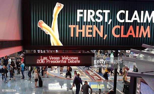 A sign at McCarran International Airport in Las Vegas Nevada welcomes the third and final presidential debate between Democratic presidential...