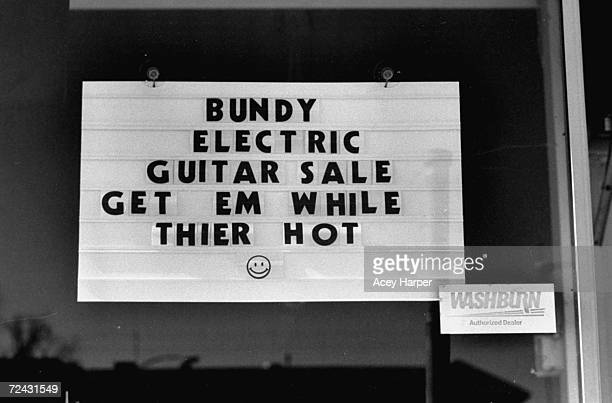 Sign at music instrument store announcing sale on electric guitars re recent execution of serial killer Ted Bundy