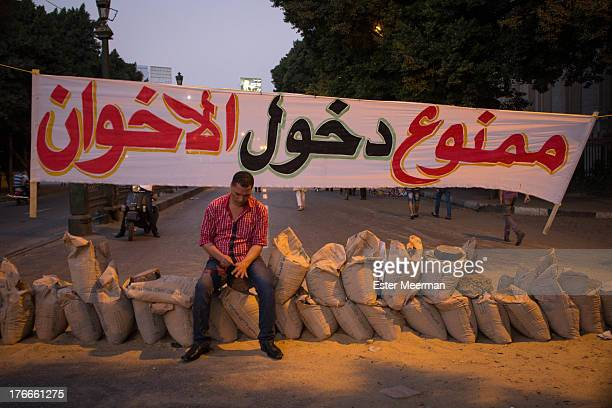 Sign at one of the entrances of Tahrir Square reads 'no entrance for the Muslim Brotherhood', as anti-Morsi protesters start to gather for big...
