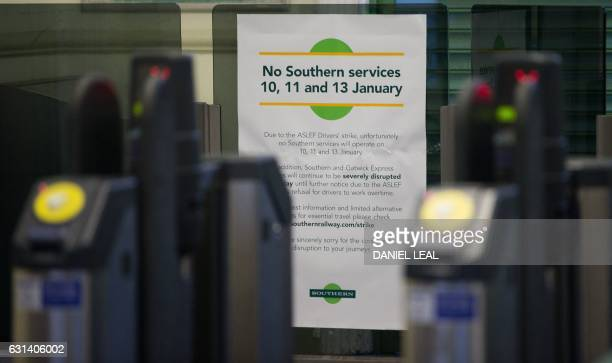 A sign at Selhurst train station advises people not to travel due to industrial action is pictured at Selhurst station south of London on January 10...