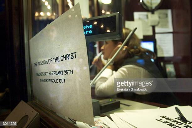 A sign at the box office at the Avalon Theater notifies moviegoers that the current showing of the premiere of Mel Gibson's 'The Passion of the...