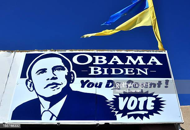 Sign at the Democratic Party's headquarters in Espanola, New Mexico, urges residents to vote for Barack Obama in the 2012 presidential election. A...