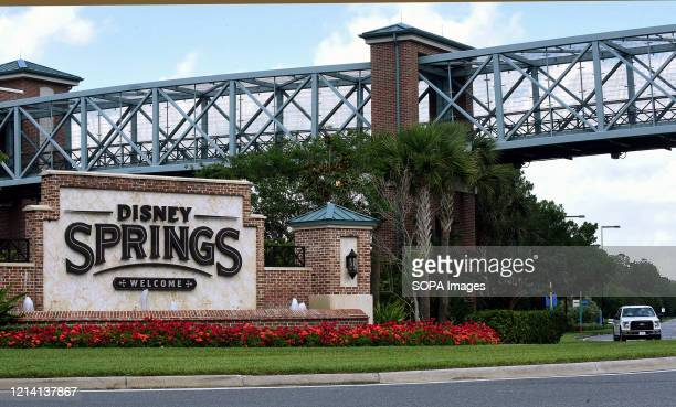 A sign at the entrance to Disney Springs at Walt Disney World is seen a day before the retail dining and entertainment complex begins a phased...