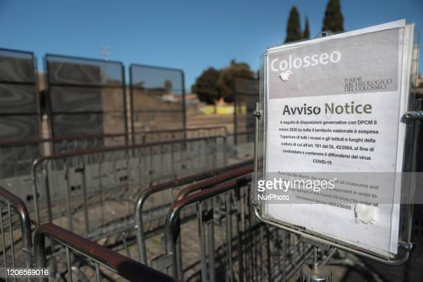 Sign at the entrance to the Colosseum indicates its closure due to government measures during the Coronavirus emergency, on March 11 in Rome, Italy....